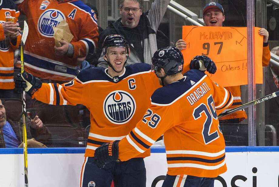 Edmonton's Connor McDavid (facing) and Leon Draisaitl celebrate a goal against Tampa Bay. Draisaitl scored one goal, three fewer than McDavid did. McDavid turned 21 last month. Photo: JASON FRANSON, Associated Press