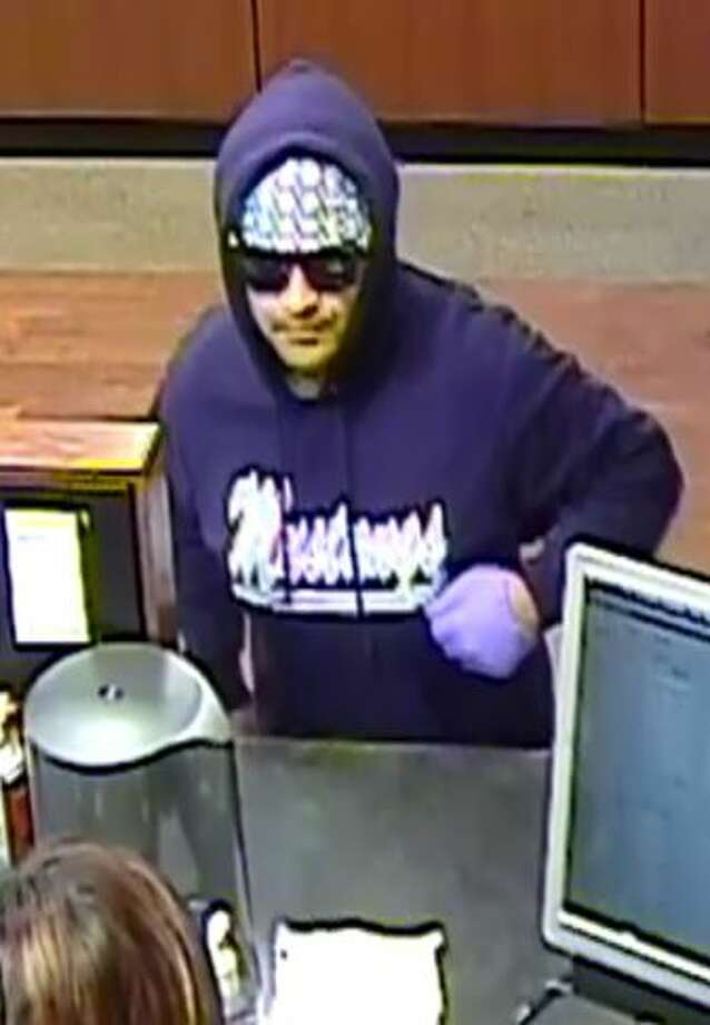 The suspect, described as a 5-foot-10-inch tall Hispanic man with a medium build and an accent, is accused of robbing the Chase Bank in the 900 block of Kitty Hawk Road on Jan. 26. Photo: Crime Stoppers
