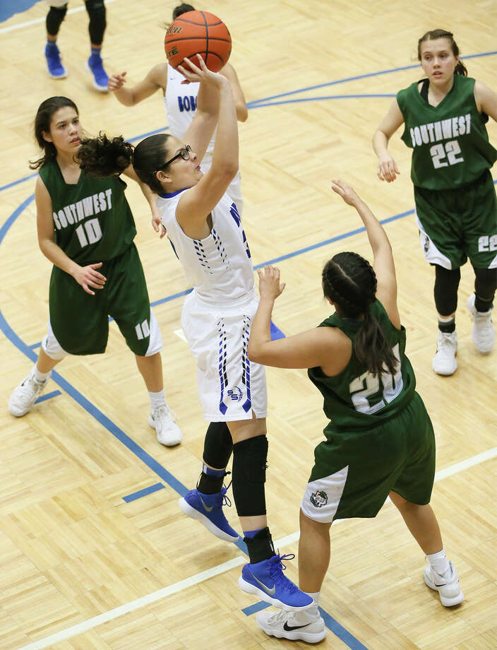 South San's Gabrila Garcia puts up a shot between Southwest's (from left)  Emily Arredondo,  Alyssa Gregg and Horalia Espinoza during the first half of their District 29-6A girls basketball game at the South San Athletic Center on Friday, Feb. 2, 2018.  South San beat Southwest 83-40.  MARVIN PFEIFFER/mpfeiffer@express-news.net Photo: Marvin Pfeiffer, San Antonio Express-News / Express-News 2018