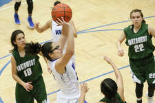 South San's Gabrila Garcia puts up a shot between Southwest's (from left)  Emily Arredondo,  Alyssa Gregg and Horalia Espinoza during the first half of their District 29-6A girls basketball game at the South San Athletic Center on Friday, Feb. 2, 2018.  South San beat Southwest 83-40.  MARVIN PFEIFFER/mpfeiffer@express-news.net