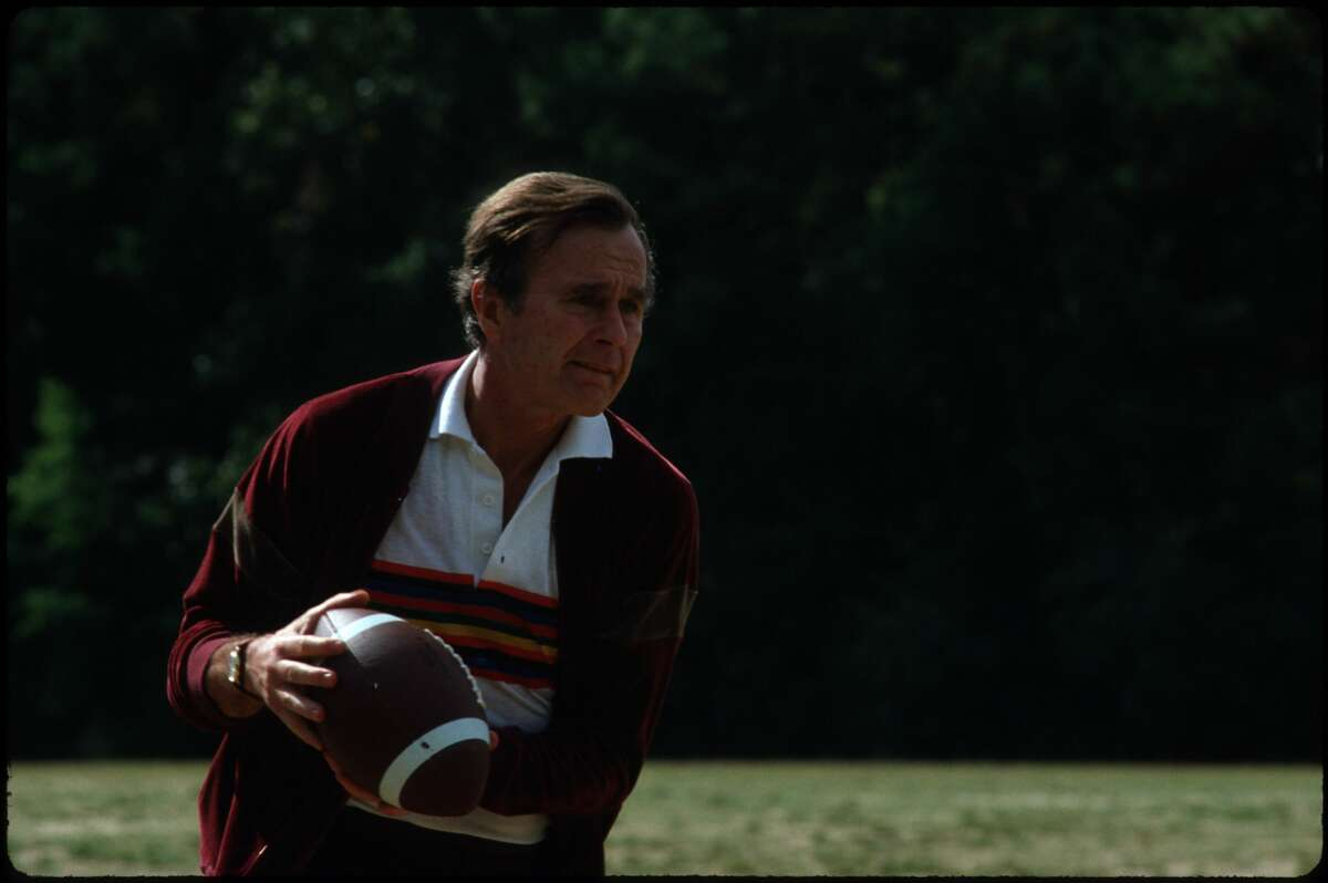 George Bush playing football November 1980 in USA. Bush is the candidate running for vice president along with Ronald Reagan.