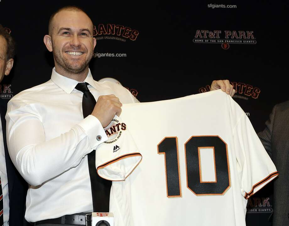 San Francisco Giants' Evan Longoria holds a jersey during a press conference announcing his recent trade to the team Friday, Jan. 19, 2018, in San Francisco.(AP Photo/Marcio Jose Sanchez) Photo: Marcio Jose Sanchez, Associated Press