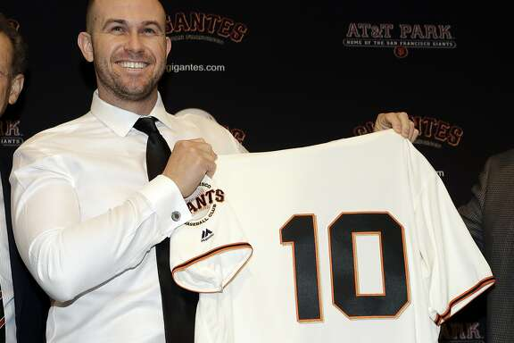 San Francisco Giants' Evan Longoria holds a jersey during a press conference announcing his recent trade to the team Friday, Jan. 19, 2018, in San Francisco.(AP Photo/Marcio Jose Sanchez)