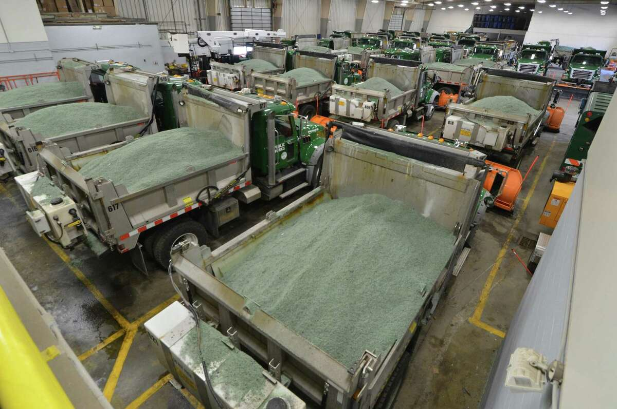 Department of Public Works trucks sit in the garage full of salt mixture for the roads in anticipation of snow on Wednesday.
