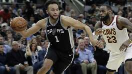 San Antonio Spurs forward Kyle Anderson (1) drives around Cleveland Cavaliers forward LeBron James (23) during the second half of an NBA basketball game, Tuesday, Jan. 23, 2018, in San Antonio. San Antonio won 114-102.