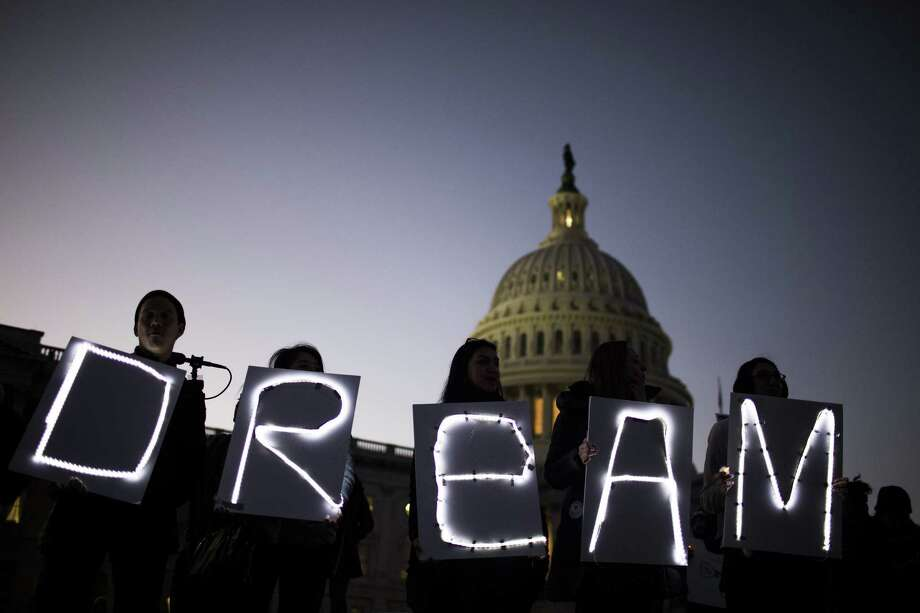 Demonstrators hold illuminated signs during a rally supporting the Deferred Action for Childhood Arrivals program (DACA), or the Dream Act, outside the U.S. Capitol building in Washington on Jan. 18, 2018. Photo: Bloomberg Photo By Zach Gibson. / © 2018 Bloomberg Finance LP