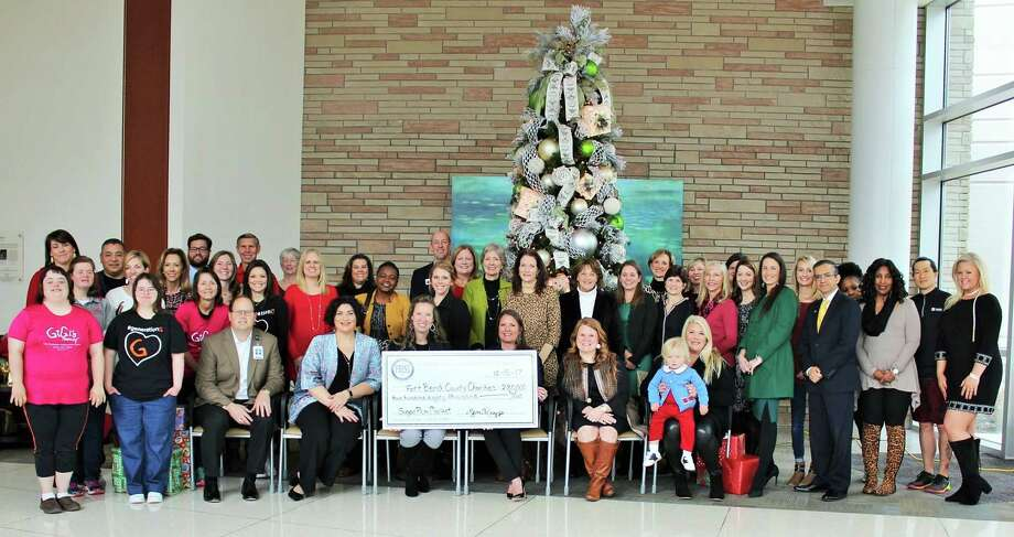 Representatives of the organizations receiving proceeds from the 2017 Sugar Plum Market joined members of FBJSL and representatives of Memorial Hermann on Dec. 15, 2017, to celebrate the Market's success. Photo: Courtesy Photo
