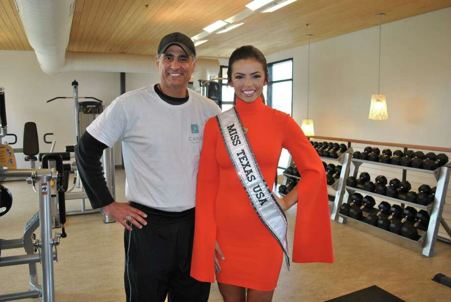 Cane Island resident fitness trainer Arnold Vasquez is shown with reigning Miss Texas USA Logan Lester. Photo: Courtesy Photo