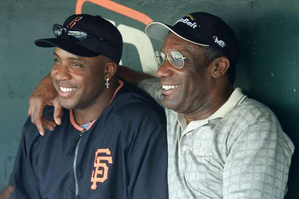 ** FILE ** San Francisco Giants' Barry Bonds, left, sits with his father, Bobby Bonds in the Giants' dugout prior to their game against the Pittsburgh Pirates in San Francisco, in this Aug. 9, 2002 photo. Bonds, one of the first major leaguers to blend home-run power with base-stealing speed and the father of one of baseball's greatest sluggers, died Saturday, Aug. 23, 2003. He was 57.  (AP Photo/Eric Risberg)--- Sent 06/13/12 18:22:35 as bondsGR_ph9 with caption: