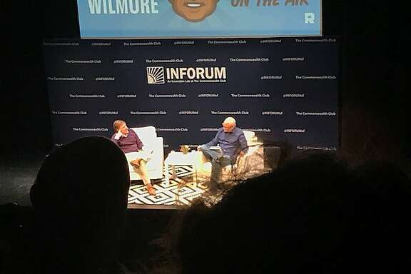 Michael Lewis and Larry Wilmore at taping of Wilmore's podcast, Black on the Air, a Commonwealth Club Inforum event