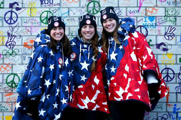 Emily Sweeney, Erin Hamlin and Summer Britcher of the United States pose in front of the Truce Wall after the team's flag raising ceremony during previews ahead of the PyeongChang 2018 Winter Olympic Games at the Pyeongchang Olympic Athletes' Village on February 6, 2018 in Pyeongchang-gun, South Korea.  (Photo by Dan Istitene/Getty Images)