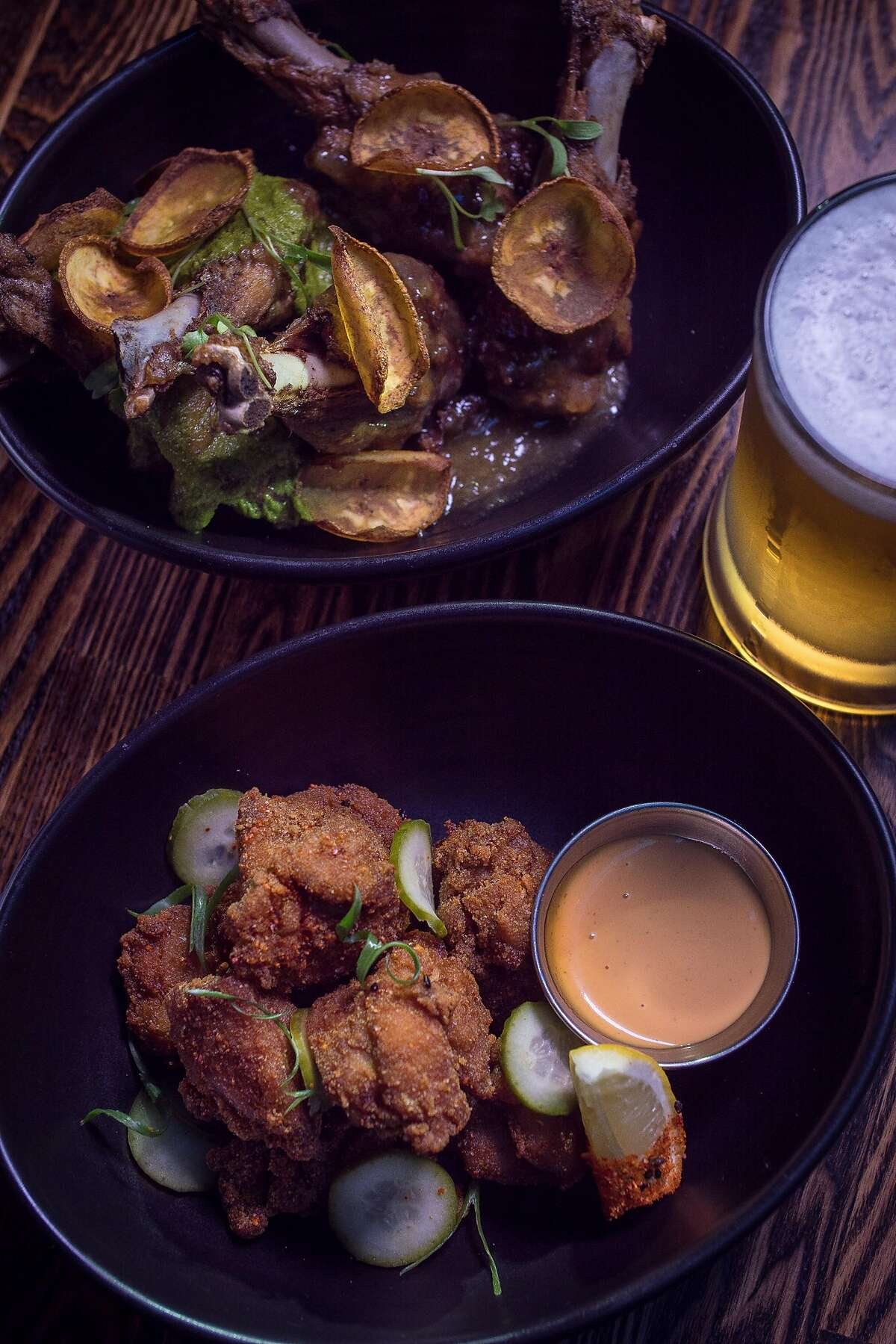 The Chicken Karaage, bottom, and the Duck Wings at International Smoke in San Francisco, Calif.ares seen on January 6th, 2018.