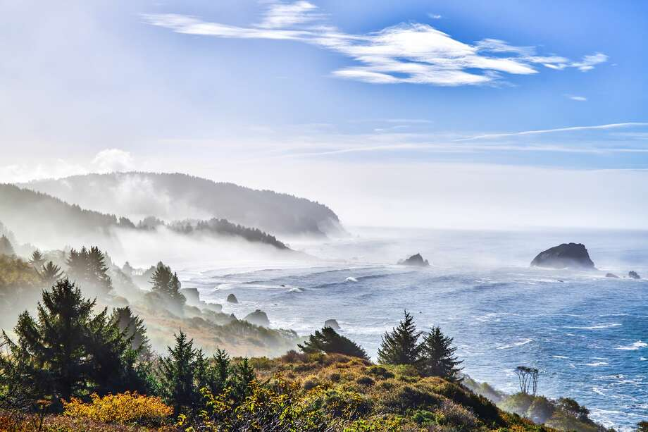 "1. Redwood Coast, California""Redwood Coast far surpass changes in (the cannabis) industry, inviting travelers to achieve the ultimate California mellow with its quirky shops, brewpubs, coffee roasters and oyster happy hours.""Pictured: Misty California Coast at early morning on highway 101 near Redwood National Park, California. Photo: Peter Unger/Getty Images/Lonely Planet Images"