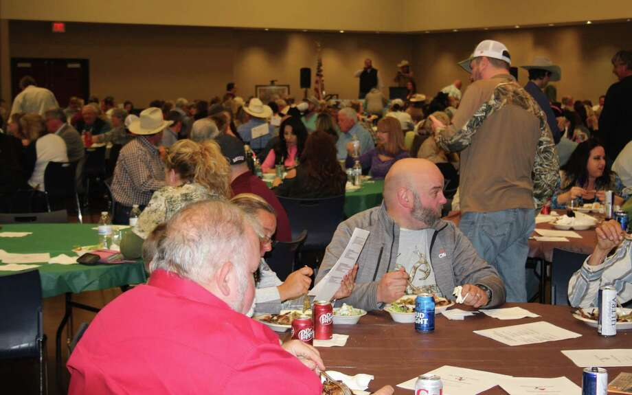 Visitors to the Ducks Unlimited Big Thicket Dinner enjoy each other's company over dinner on Saturday at the Cleveland Civic Center. The Big Thicket Chapter hosts its annual fundraising dinner in Cleveland. Money raised goes toward conservation of wetlands and upland habitats for ducks and other fowl. Photo: Jacob McAdams