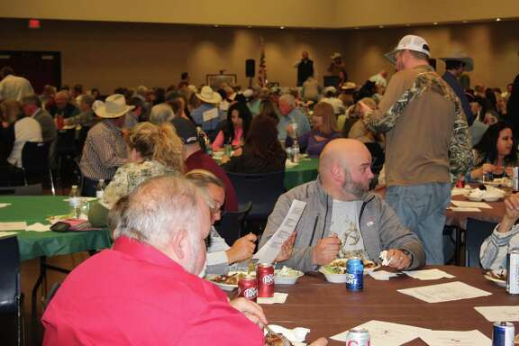 Visitors to the Ducks Unlimited Big Thicket Dinner enjoy each other's company over dinner on Saturday at the Cleveland Civic Center. The Big Thicket Chapter hosts its annual fundraising dinner in Cleveland. Money raised goes toward conservation of wetlands and upland habitats for ducks and other fowl.