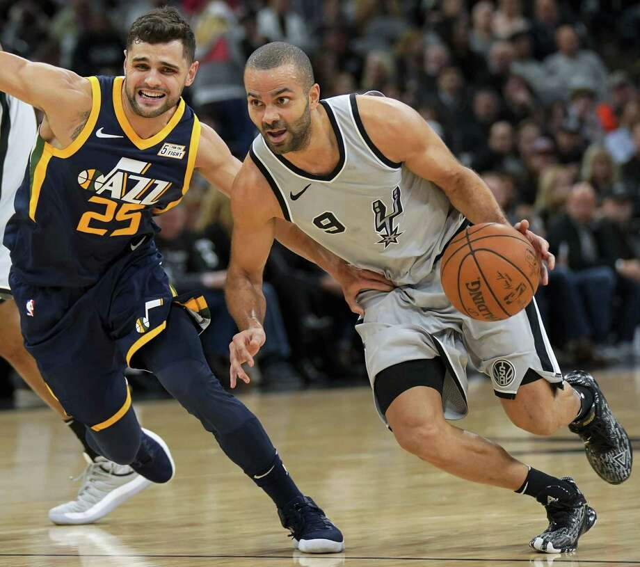 San Antonio Spurs' Tony Parker (9) drives around Utah Jazz' Raul Neto during the first half of an NBA basketball game, Saturday, Feb. 3, 2018, in San Antonio. Photo: Darren Abate /Associated Press / FR115 AP