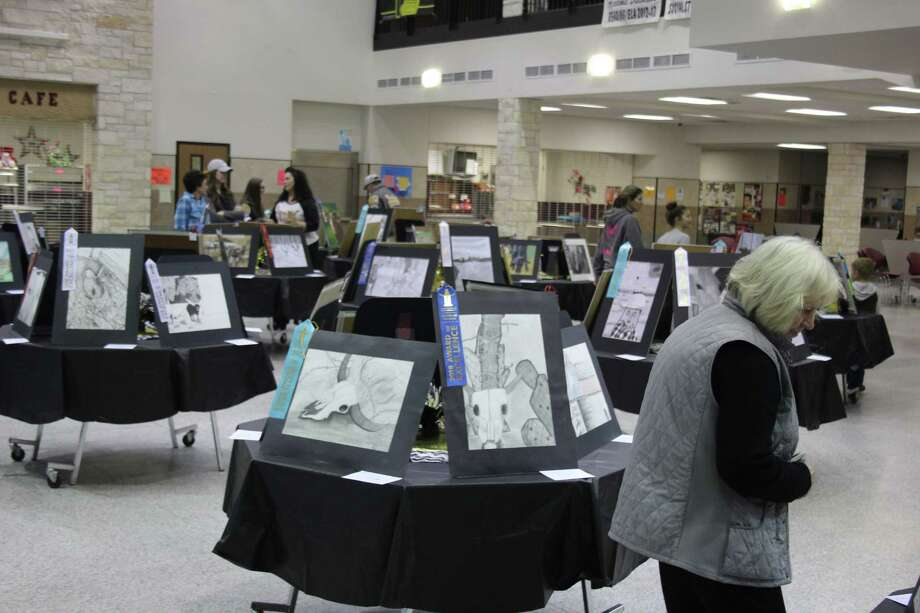 Parents, family and friends admire nearly 150 works of art on display at Tarkington High School on Feb. 3 and created by Tarkington ISD students. Photo: Jacob McAdams