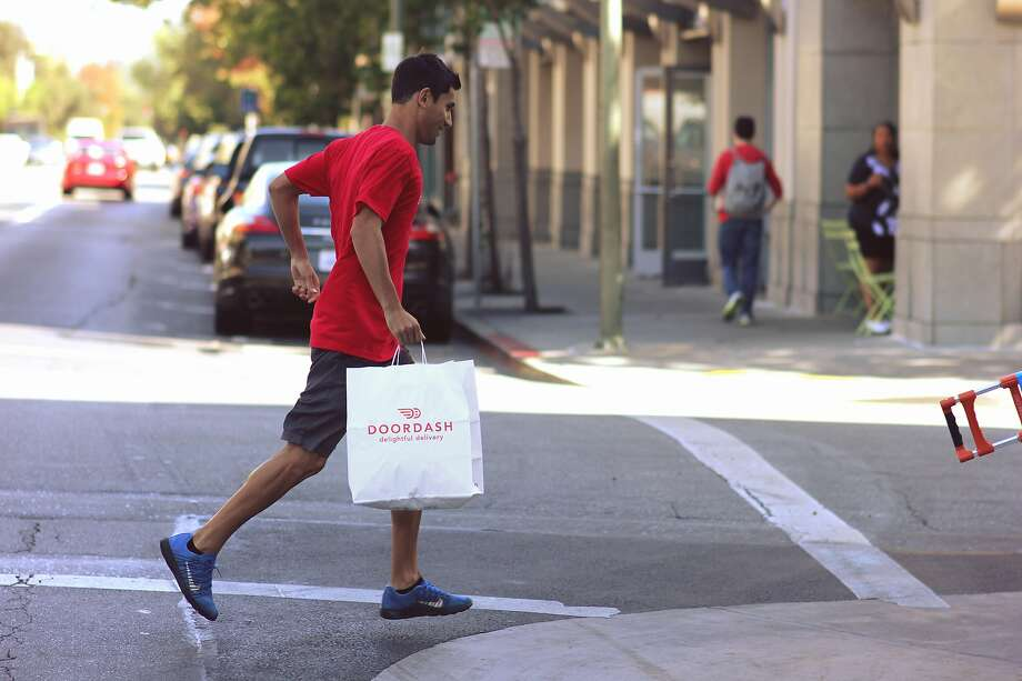 Food delivery is summoned with the tap of a DoorDash app, and the goods brought by a gig economy worker. Photo: Contributed Photo / DoorDash, Contributed