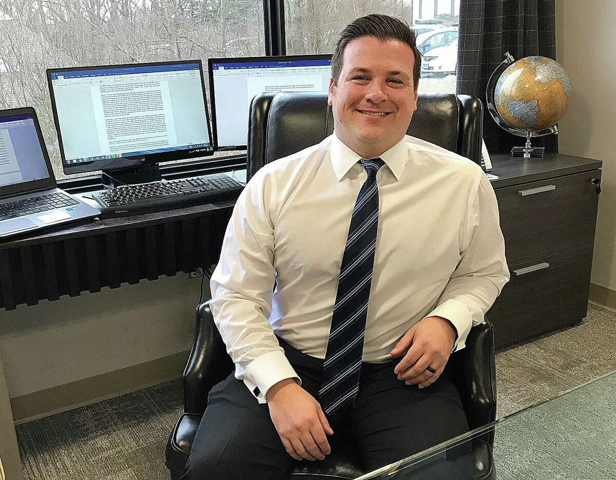 Joshua Weinshank of the law firm Cramer & Anderson sits in the firm's new office in Ridgefield, Conn., on Tuesday, Feb 6, 2018.