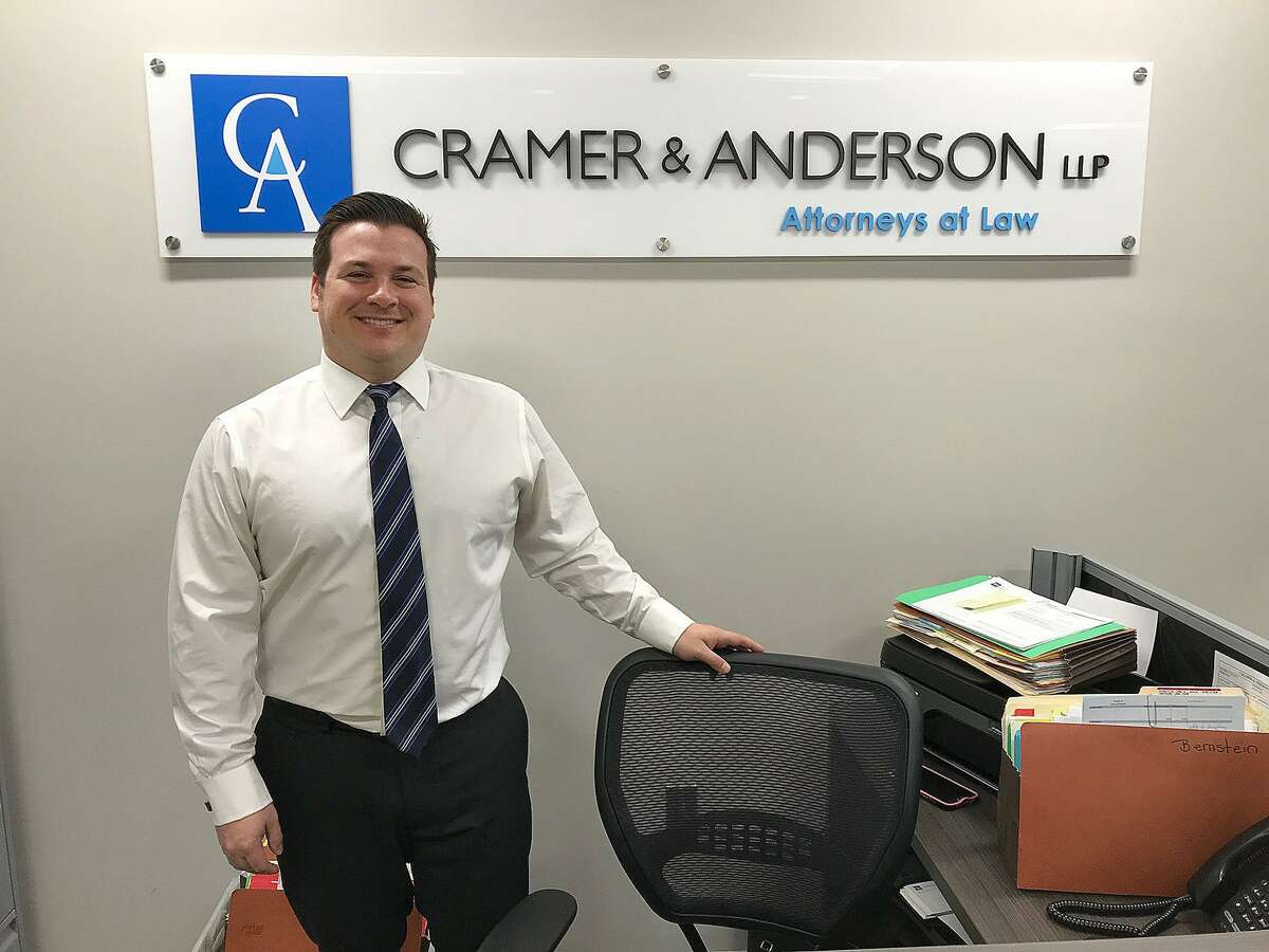 Joshua Weinshank of the law firm Cramer & Anderson stands in the firm's new office in Ridgefield on Tuesday.