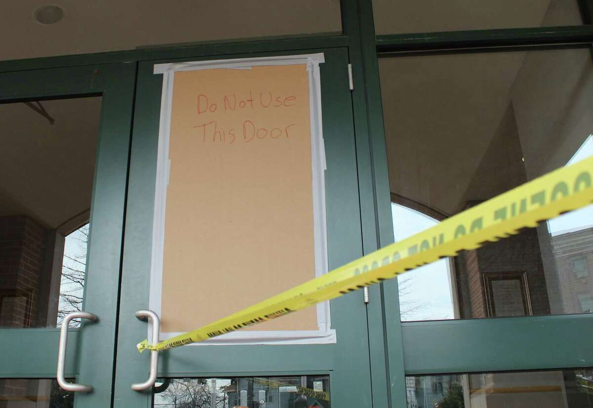 Norwalk Police covered the broken window at the department's entrance with cardboard until it could be repaired after a man smashed it with a brick on Tuesday, Feb. 6, 2018.