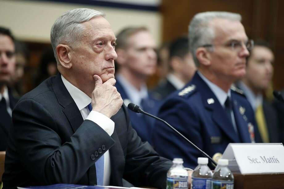 Defense Secretary Jim Mattis (left) linked a new U.S. cruise missile to a Russian treaty violation. Photo: Alex Brandon, Associated Press