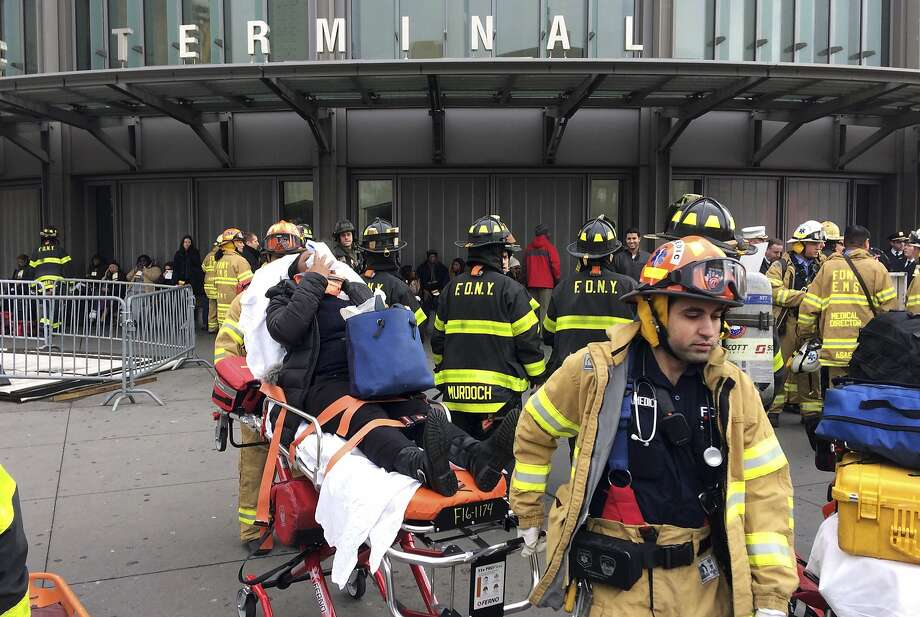 An injured passenger is taken from a Brooklyn terminal after a Long Island Railroad train crashed last year, killing one person and injuring some 200. Photo: Mark Lennihan, Associated Press