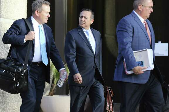 State Sen. Carlos Uresti (center) leaves with his attorneys from the John Wood Federal Courthouse after another day of testimony surrounding his indictment last year on 11 felony charges, including conspiracy to commit wire fraud, securities fraud and money laundering, in connection with his role at FourWinds Logistics.