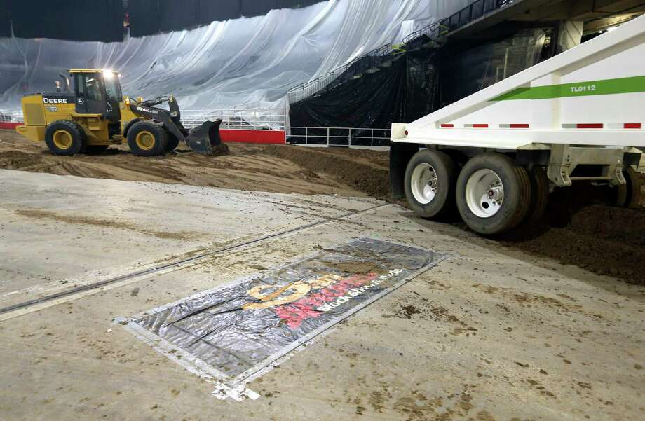 Dirt for the San Antonio rodeo is trucked Monday, Feb. 5, 2018 into the AT&T Center in advance of Thursday's opening night. Photo: William Luther, San Antonio Express-News / © 2018 San Antonio Express-News