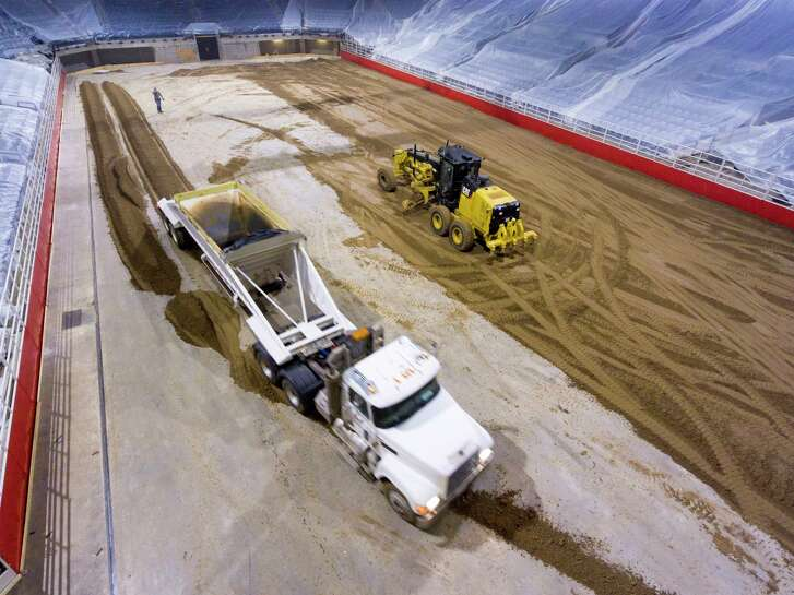 Dirt for the San Antonio rodeo is trucked Monday, Feb. 5, 2018 into the AT&T Center in advance of Thursday's opening night.