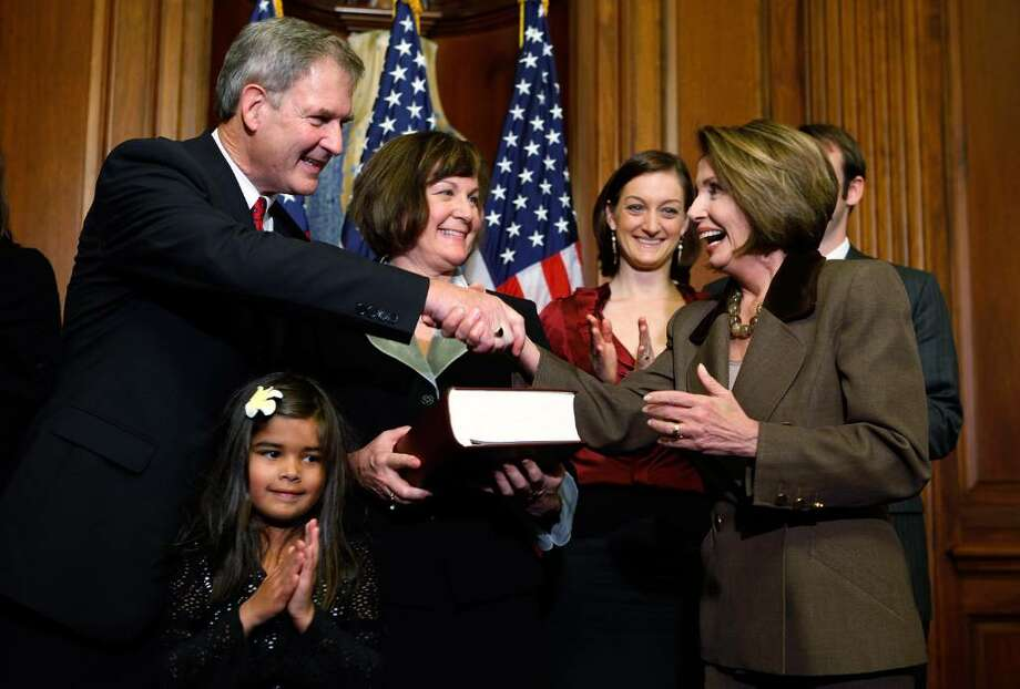 WASHINGTON - NOVEMBER 06:  U.S. Speaker of the House Nancy Pelosi, right, shakes hands with Rep. Bill Owens, left, as Owens' granddaughter Caroline Antonipillai, wife Jane and daughter Jenna look on during a mock swearing in November 6, 2009 on Capitol Hill in Washington, DC. Owens won the special election for seat that was vacated by John McHugh.  (Photo by Alex Wong/Getty Images) Photo: Alex Wong / Getty Images North America
