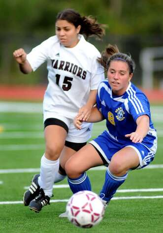 Stillwater's Sarahann Mistretta, left, pursues Granville's Molly Narkiewicz. (Cindy Schultz / Times Union) Photo: CINDY SCHULTZ