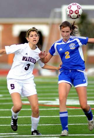Stillwater's Rebecca Wichelns, left, battles Granville's Meghan O'Brien for control of the ball. (Cindy Schultz / Times Union) Photo: CINDY SCHULTZ