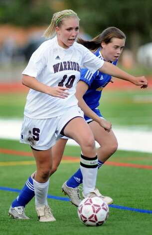 Stillwater's Abbey Hanehan, left, controls the ball against Granville's Meghan O'Brien. (Cindy Schultz / Times Union) Photo: CINDY SCHULTZ