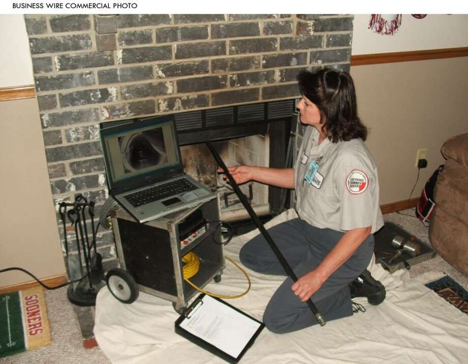 Experts recommend that people with oil furnaces or wood-burning stoves have their chimneys cleaned and inspected by a professional at least once a year. (Business Wire) / Chimney Safety Institute of Amer