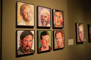 "An exhibit view of ""Portraits of Courage"" at the George W. Bush Presidential Library and Museum in Dallas."