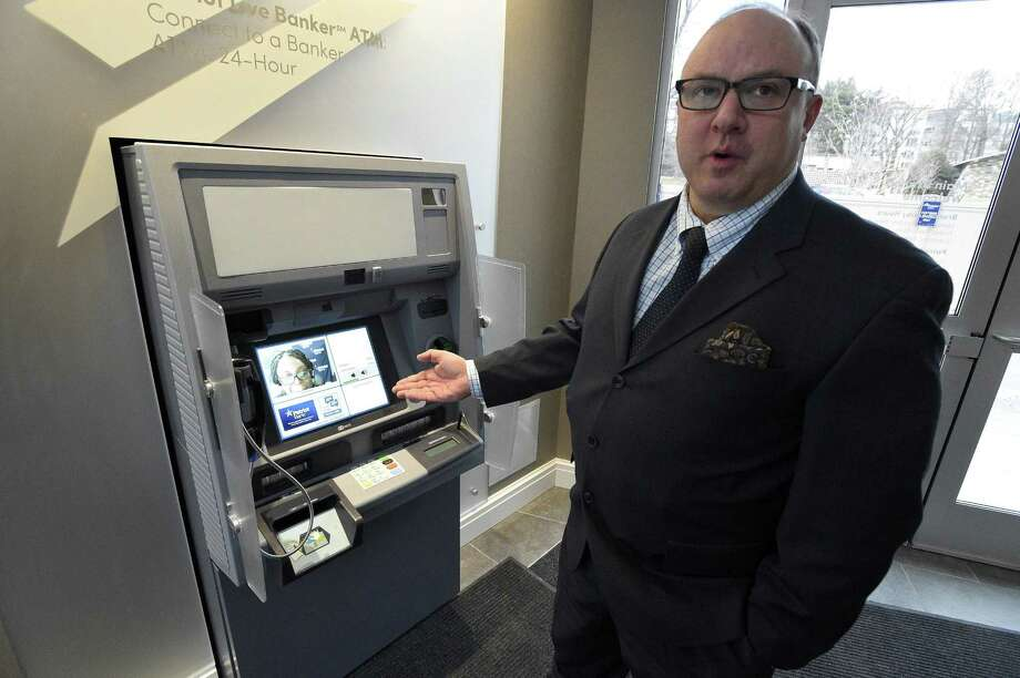 Rick Muskus Jr., president of Patriot Bank, shows an interactive teller machine, with video-conferencing technology, at Patriot's new flagship branch at 999 Bedford St., in Stamford, Conn., on Wednesday, Jan. 31, 2018. Photo: Matthew Brown / Hearst Connecticut Media / Stamford Advocate