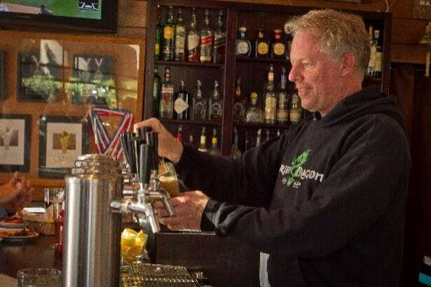 21st Amendment co-founder Shaun O'Sullivan pours a beer at the South of Market brew pub. (2012)