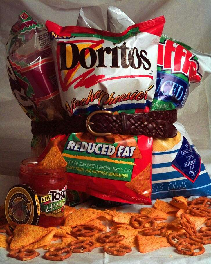Frito-Lay is adding a skinnier version of Doritos to the fray of low-fat, no-fat and fake fat products, as shown in this July 17, 1996 photo, to reach those people looking for slimmer alternatives. (AP Photo/Eric Gay)