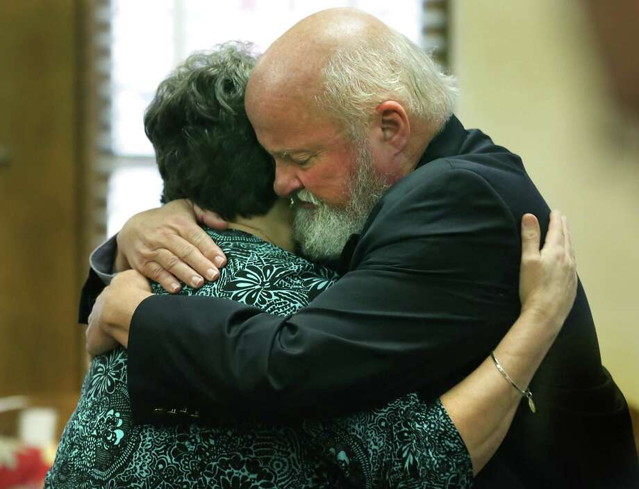 Timothy Mott, right, hugs his wife Sharlotte Mott, after she testified on the sixth day of testimony in the civil case against MPII, which does business as Mission Park Funeral Chapels and Cemeteries, accused of losing a body from a casket in 2015, in the 131st Civil District Court on Tuesday, Feb. 6, 2018. Photo: Bob Owen /San Antonio Express-News / ©2018 San Antonio Express-News