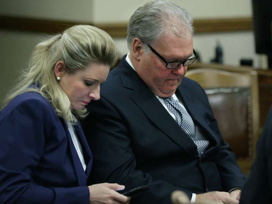 "MPII Inc. owner Robert ""Dick"" Tips, right, and his wife Kristin Tips check their phones during the sixth day of testimony in the civil case against his company, accused of losing a body from a casket inside his funeral facility in 2015, in the 131st Civil District Court on Tuesday, Feb. 6, 2018. Photo: Bob Owen /San Antonio Express-News / ©2018 San Antonio Express-News"