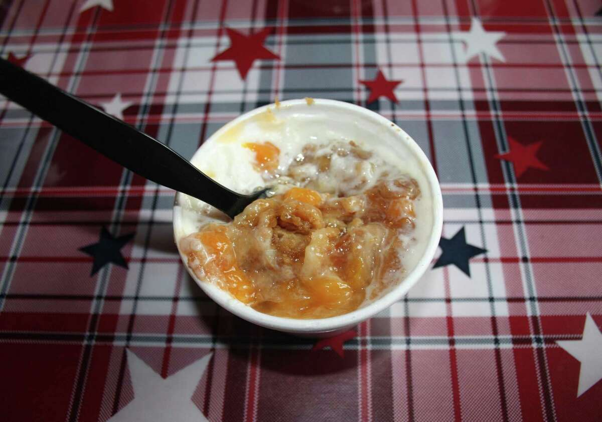 The peach cobbler (pictured) and apple cobbler at the Rusty Bucket BBQ are cooked in the smoker and pick up a noticeable smoky taste from the oak wood.
