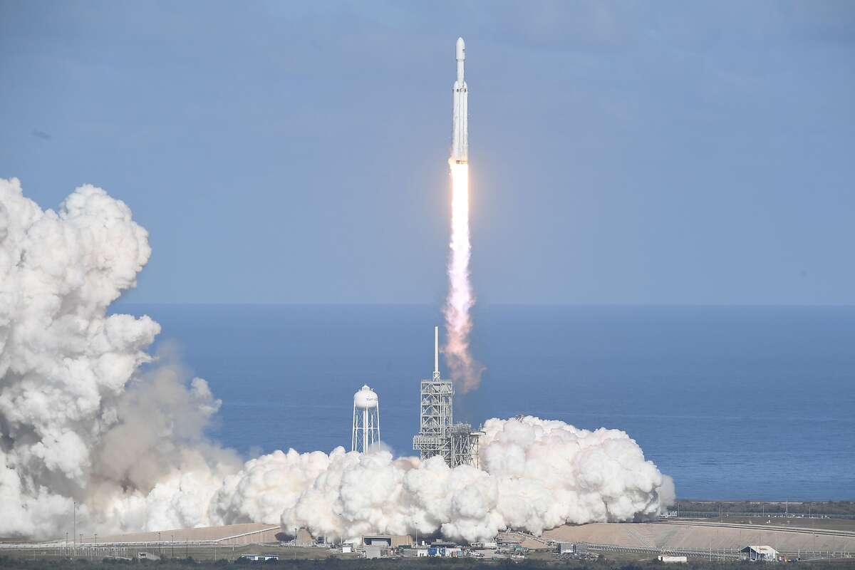 The SpaceX Falcon Heavy takes off from Pad 39A at the Kennedy Space Center in Florida, on February 6, 2018, on its demonstration mission. The world's most powerful rocket, SpaceX's Falcon Heavy, blasted off Tuesday on its highly anticipated maiden test flight, carrying CEO Elon Musk's cherry red Tesla roadster to an orbit near Mars. Screams and cheers erupted at Cape Canaveral, Florida as the massive rocket fired its 27 engines and rumbled into the blue sky over the same NASA launchpad that served as a base for the US missions to Moon four decades ago.