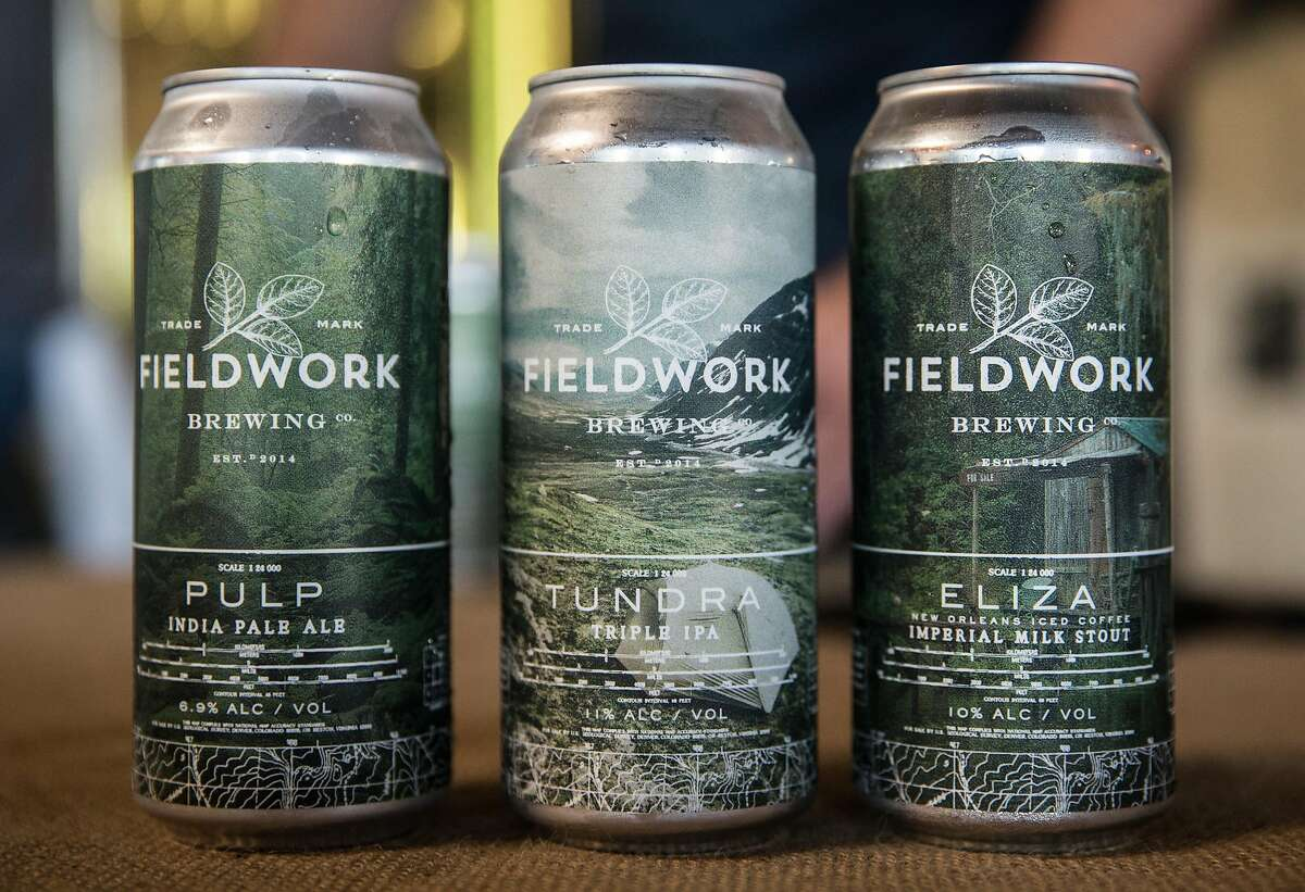 Beers Pulp, Tundra and Eliza are seen on display during their special can release at Fieldwork Brewing Company Saturday, Feb. 3, 2018 in Berkeley, Calif.