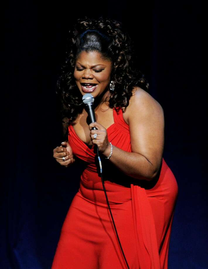 "Mo'Nique performs at the Nokia Theater in Los Angeles during her ""Spread the Love"" comedy tour. Photo: Kevin Winter, Getty Images"
