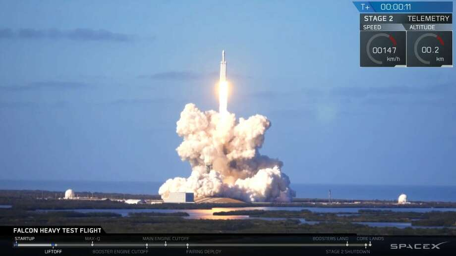 In this image from video provided by SpaceX, two booster rockets land at Cape Canaveral, Fla., during the first test flight of the Falcon Heavy rocket on Tuesday, Feb. 6, 2018. Photo: Courtesy SpaceX