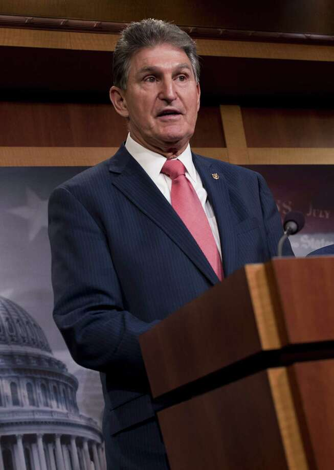 Sen. Joe Manchin, a Democrat from West Virginia, left, speaks during a news conference at the U.S. Capitol in Washington on Monday, Jan. 22. Photo: Bloomberg Photo By Aaron P. Bernstein. / Bloomberg