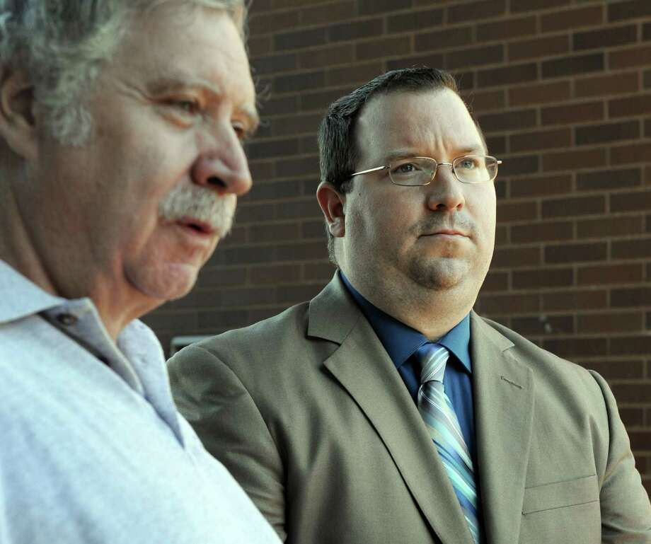Former Danbury Police Officer Christopher Belair, right, with his father, Stephen, talks to the press at the conclusion of his trial in 2015 after being found not guilty of assault and threatening charges.. Photo: Carol Kaliff / Hearst Connecticut Media / The News-Times