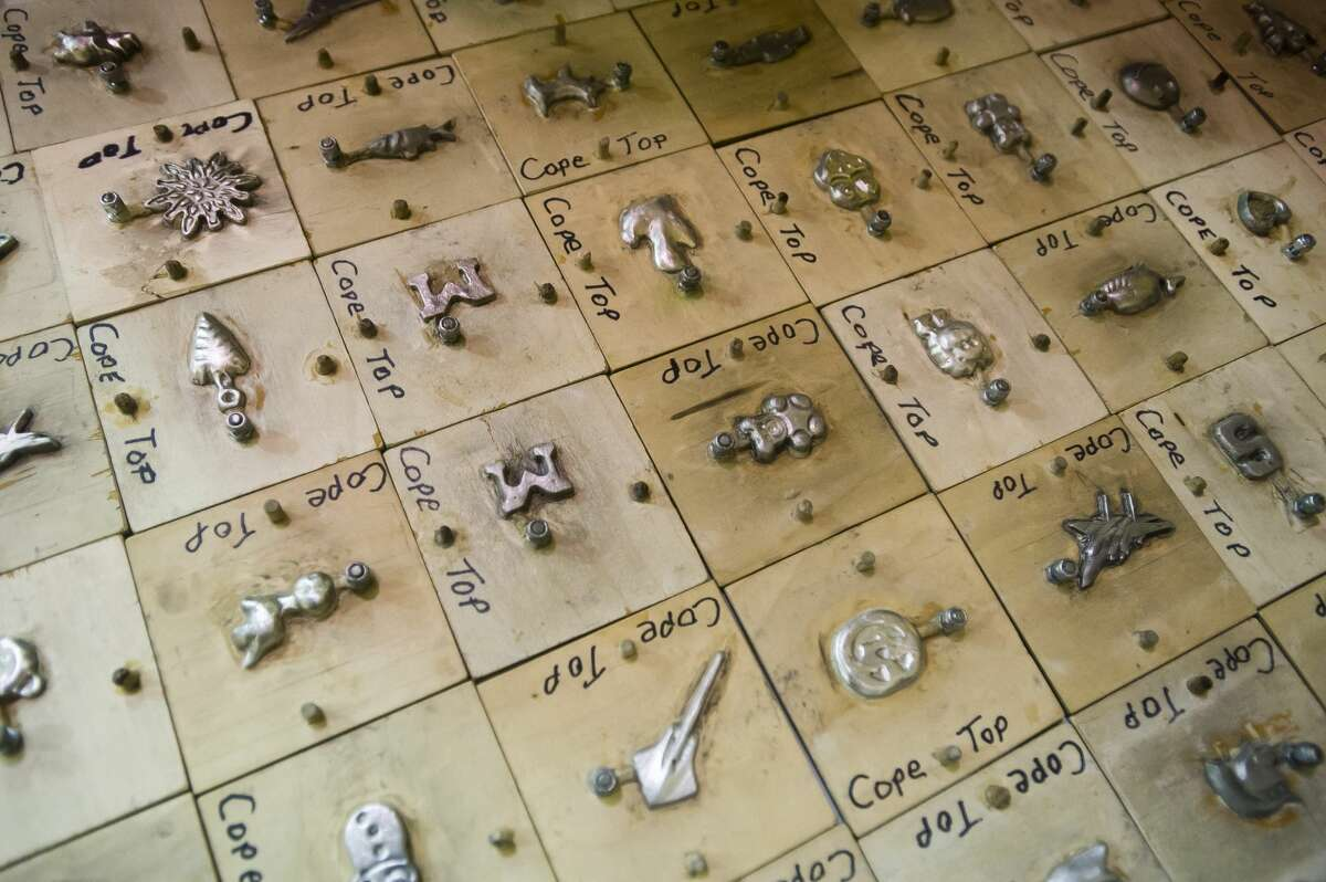 Tin tokens are displayed during a
