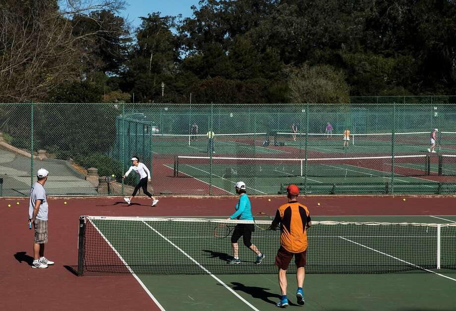 People occupy multiple courts for both lessons and leisure at the Golden Gate Park Tennis Center. Photo: Jessica Christian, The Chronicle
